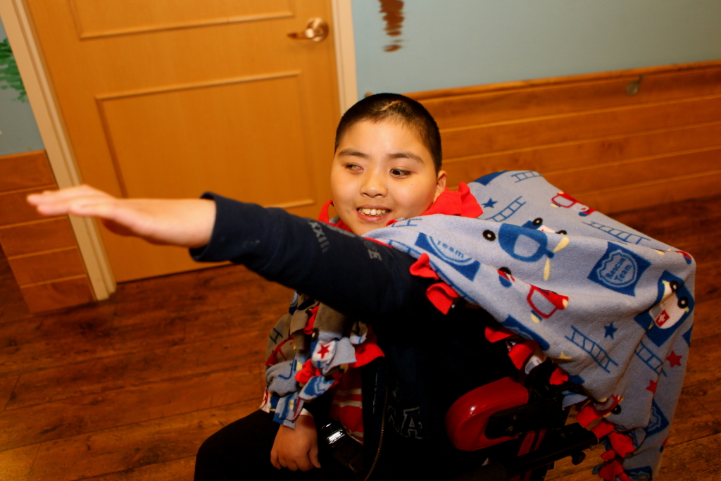 photo 5: boy in wheelchair pretending to be superman